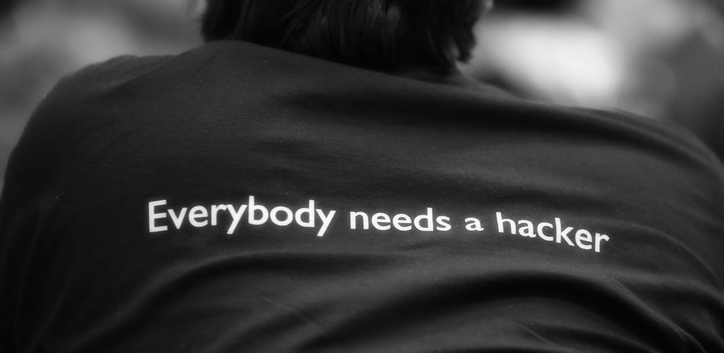 """Everbody needs a hacker"" written on a shirt at FOSDEM 2013"